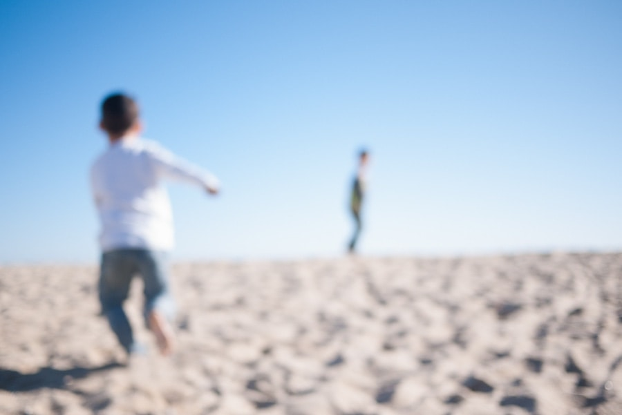 two boys running beach